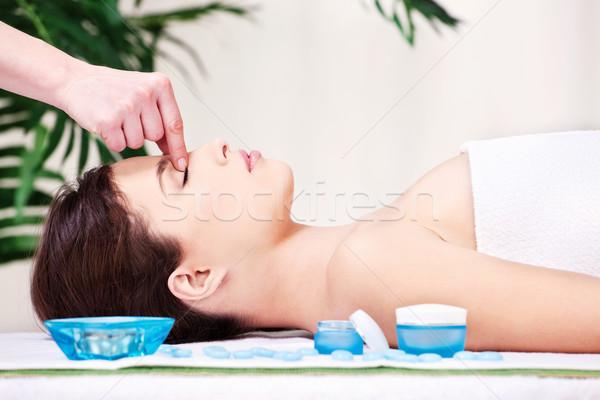 forehead massage treatment in spa salon Stock photo © imarin