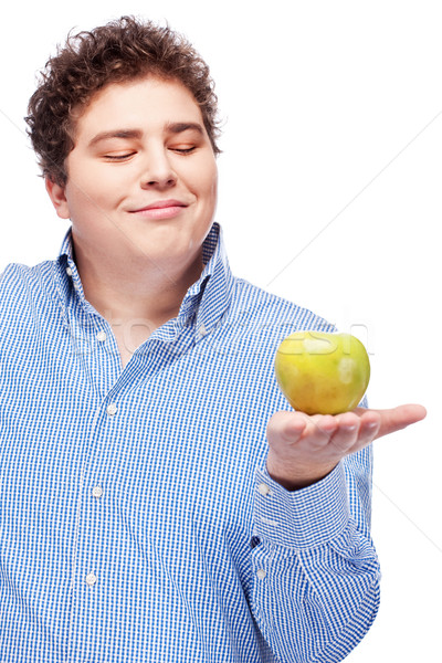 chubby man holding apple Stock photo © imarin