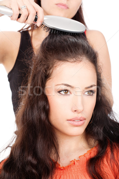 hairdresser combing costumer's long black hair Stock photo © imarin