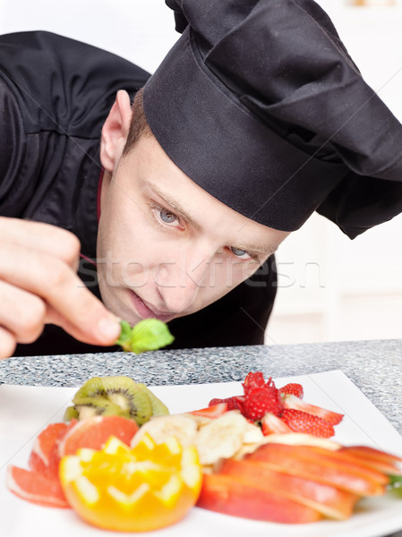 Stock photo: chef decorating delicious fruit plate