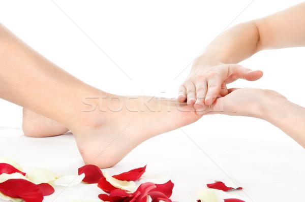Láb masszázs izolált fehér lány kéz Stock fotó © imarin