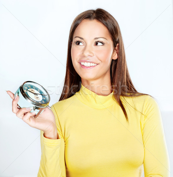 Happy woman holding alarm clock  Stock photo © imarin