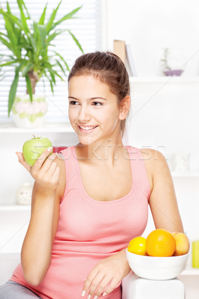 happy woman at home with fruits Stock photo © imarin