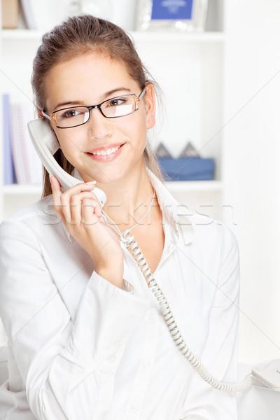 Woman on land line call Stock photo © imarin