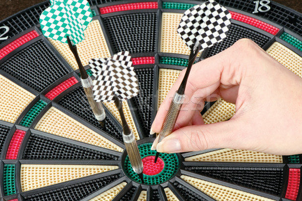 Taking out dart from dartboard Stock photo © imarin