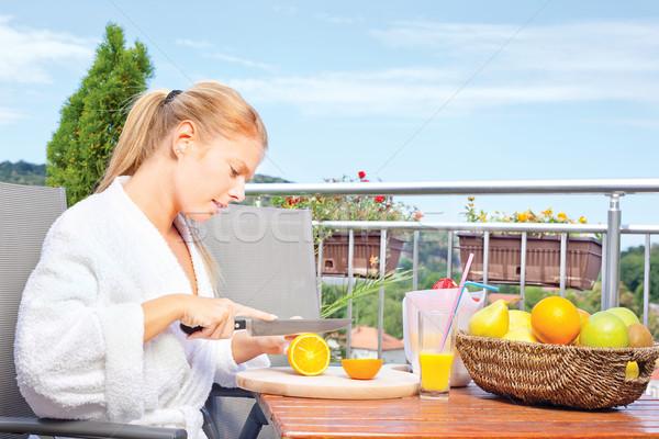 Woman making morning juice on terrace Stock photo © imarin