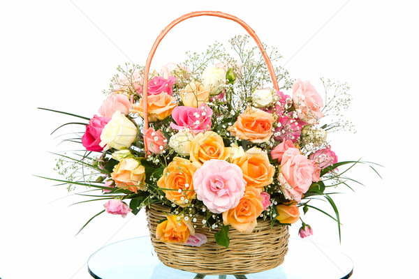 Basket with colored roses Stock photo © imarin