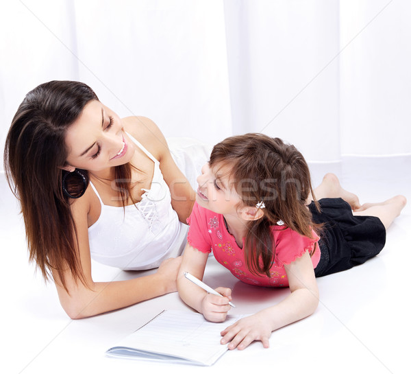 Woman and child drawing on notepad Stock photo © imarin