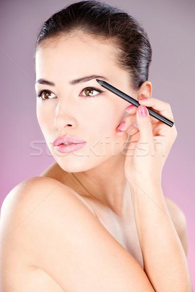 woman applying cosmetic pencil on eye Stock photo © imarin