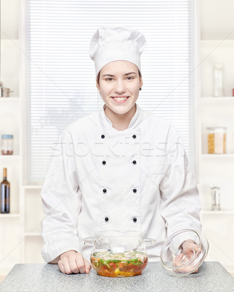 Chef with a soup of vegetables in a glass pot Stock photo © imarin