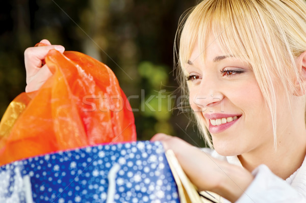 Woman checking out bag content Stock photo © imarin