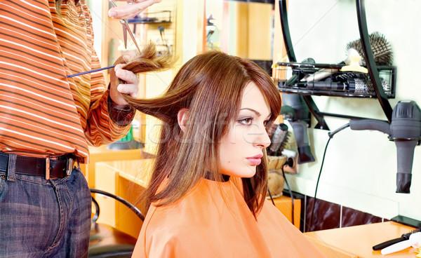hands of hairdresser cutting hair Stock photo © imarin