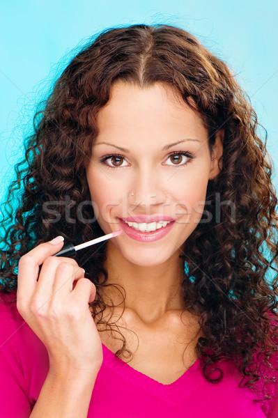 woman putting lipstick on lips Stock photo © imarin