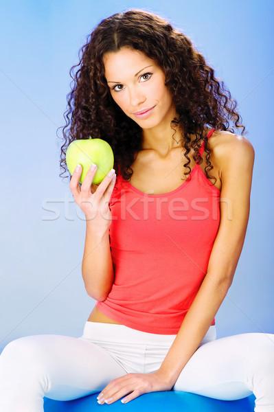 women seating on blue pilates ball holding green apple Stock photo © imarin