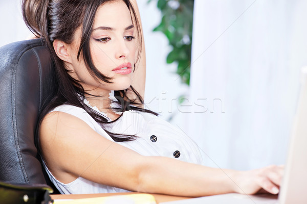 Bussines woman working on computer in office Stock photo © imarin