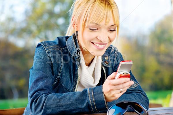 woman at park taking a phone call Stock photo © imarin