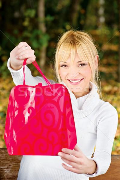 woman showing her shopping bag Stock photo © imarin
