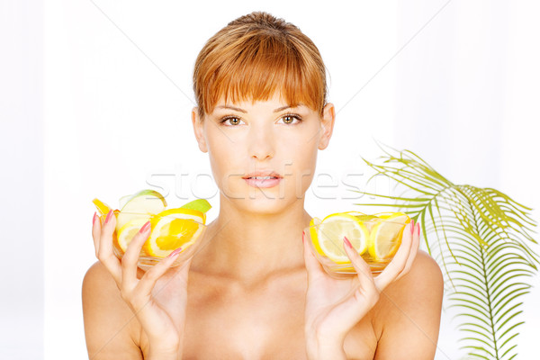 girl with two bowl full of fruit Stock photo © imarin