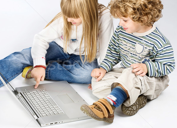 Stock photo: girl and boy seating near laptop