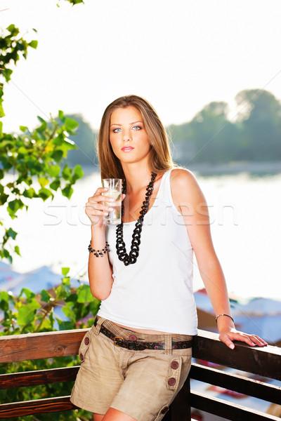 Fiatal nő folyó csinos nő tart üveg víz Stock fotó © imarin
