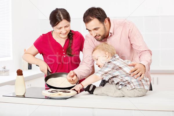 family makes pancakes in the kitchen Stock photo © imarin