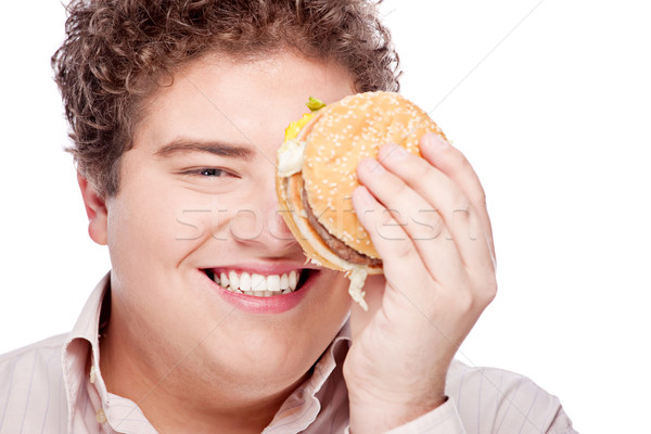 Young chubby man holding  hamburger Stock photo © imarin