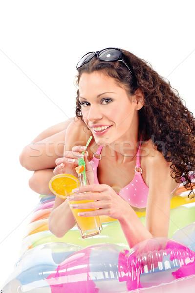 девушки пить сока воздуха матрац изолированный Сток-фото © imarin
