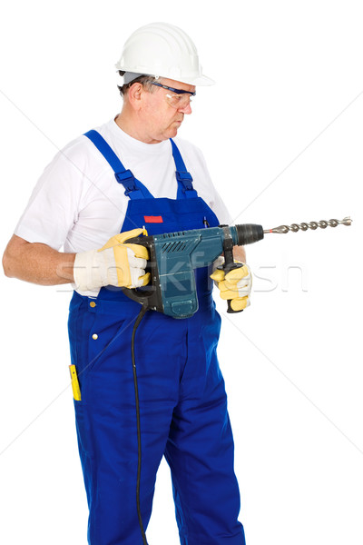 man wearing worker suite holding drill for concrete Stock photo © imarin