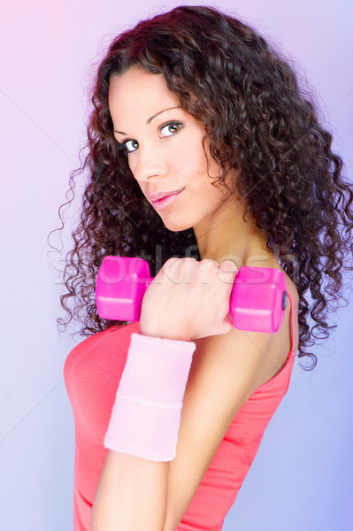 curls hair girl holding weight for exercise Stock photo © imarin