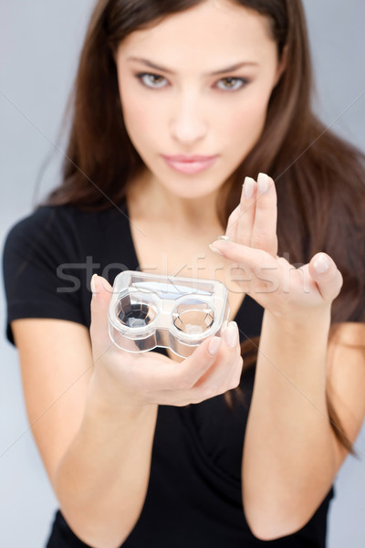 woman hold contact lenses cases and lens Stock photo © imarin