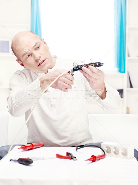 man doing minor repair at home Stock photo © imarin