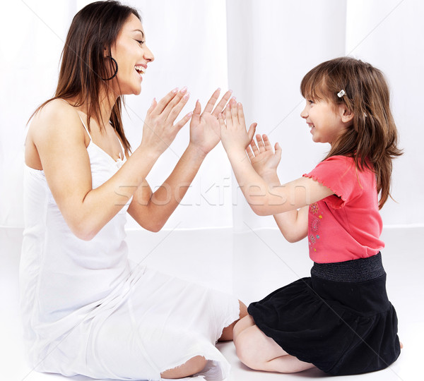 Woman and child laughing and playing Stock photo © imarin