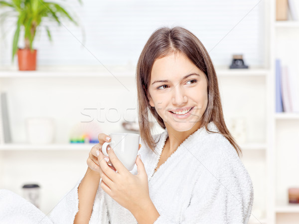Woman in bathrobe relaxing at home Stock photo © imarin