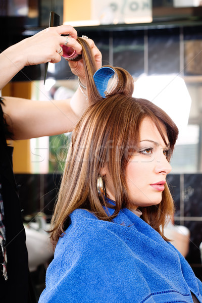 hairdresser putting rollers on hair Stock photo © imarin