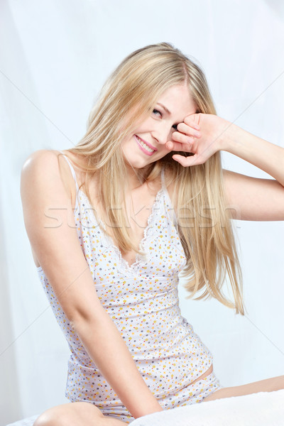 girl on bed waking Stock photo © imarin