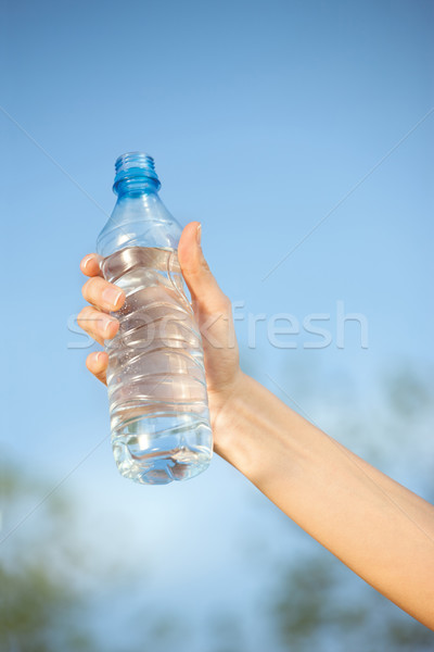 hand holding plasic bottle of water  Stock photo © imarin