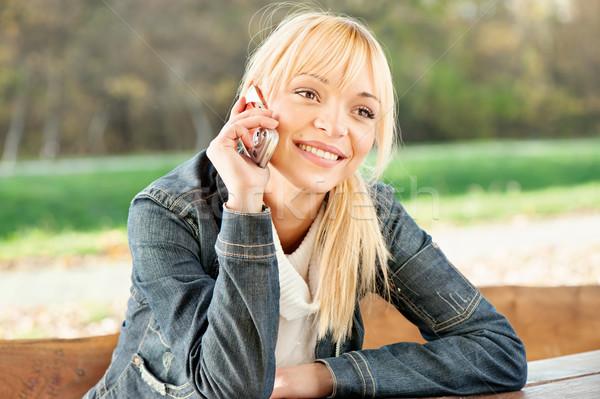 Nő park elvesz telefonbeszélgetés szőke mosoly Stock fotó © imarin