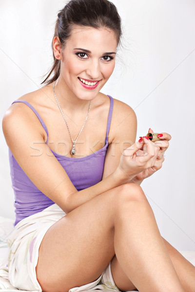 girl in bed girl applying nail polish Stock photo © imarin
