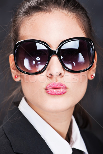 Stock photo: girl with big sun glasses sending kiss