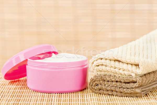 cream in pink cup with towels Stock photo © imarin