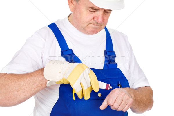 Middle age worker putting cream on his wound Stock photo © imarin
