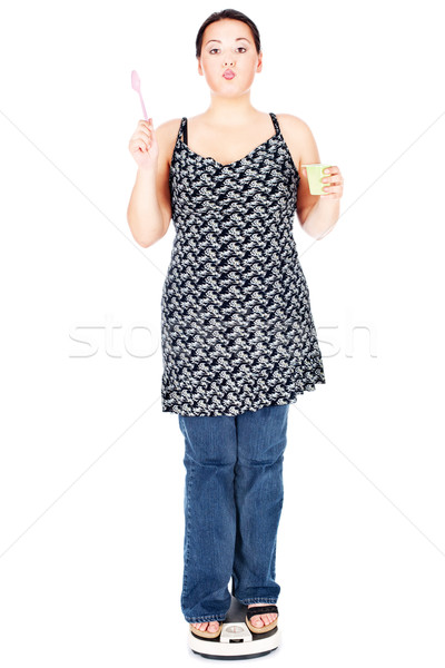 woman on scale holding spoon and pudding Stock photo © imarin