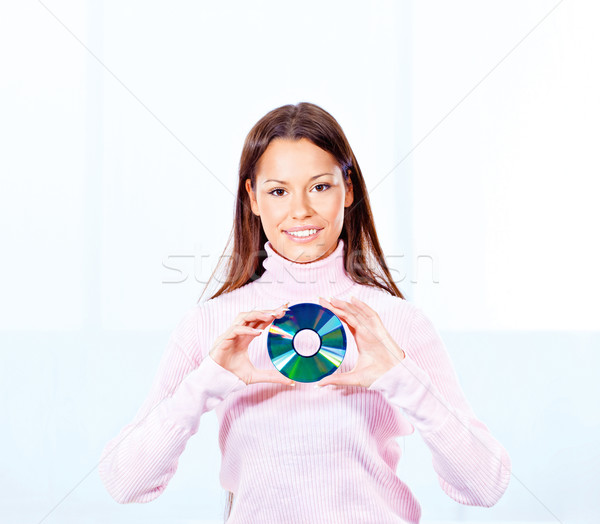 Kadın cd disk esmer Stok fotoğraf © imarin