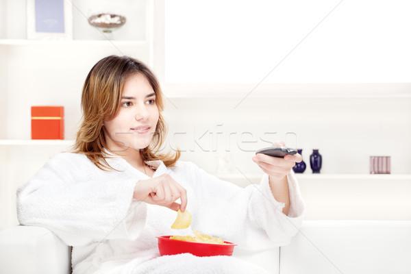 teenager girl at home watching television Stock photo © imarin