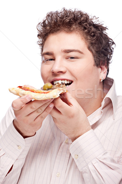 Happy chubby boy eating a slice of pizza Stock photo © imarin