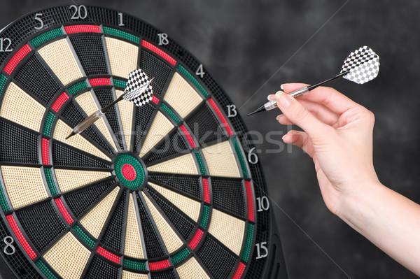 arrow in hand and dartboard Stock photo © imarin