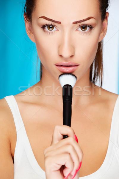woman holding powder brush Stock photo © imarin