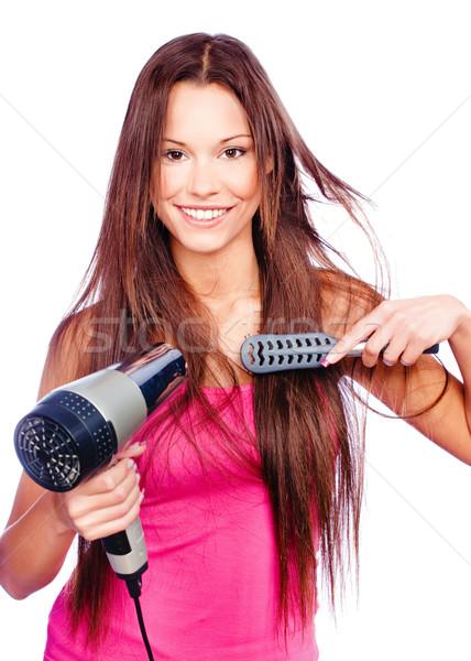 Vrouw blazen kam lang haar geïsoleerd Stockfoto © imarin