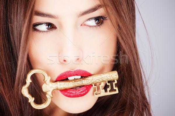 Nő tart nagy öreg kulcs csinos nő Stock fotó © imarin