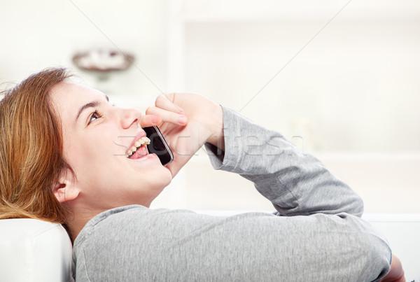 woman have joyful talk over telephone Stock photo © imarin